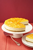 Campari orange cake, a piece taken, on cake stand