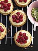 Raspberry semolina tarts on cake rack