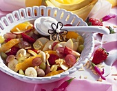 Fruit salad with slivered almonds and cream