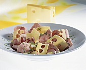 Swiss sausage salad with Emmental cheese and radishes