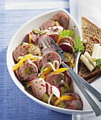 Spicy sausage, radish and pepper salad