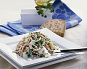 Sausage and vegetable salad with yoghurt dressing