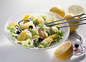 Savoury citrus fruit salad with olives and onions