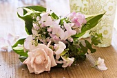 Bouquet of roses, sweet peas, thyme, hosta leaves, ivy