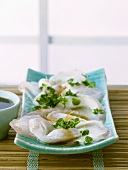 Raw fish fillets with shiso cress