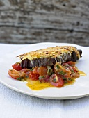 Boiled beef with potato crust and stewed tomatoes