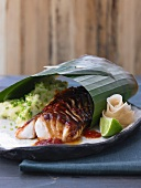 Cod with mashed potato in banana leaf (Japan)