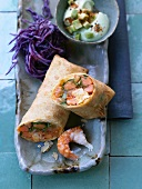 Shrimp & surimi spring roll with red cabbage & avocado cream