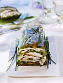 Poultry terrine with peas and chives
