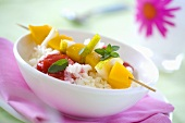 Fruit skewers on rice for children