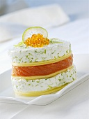 Tower of pastry, salmon & goat's cheese topped with caviar