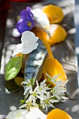Mackerel with carrots and edible flowers