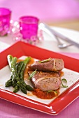 Pork with tomato sauce and green asparagus