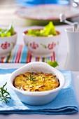 Potato gratin with rosemary in baking dish