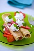 Pancakes with strawberries, cream and lemon balm