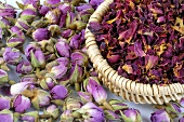 Dried rosebuds and petals in basket