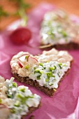 Wholemeal bread hearts topped with cottage cheese, chives & radishes