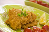 Deep-fried fish fillets with cherry tomatoes