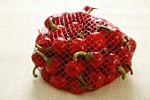 Cherry peppers in a red net