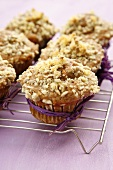 Apple muffins with sunflower seeds on cake rack