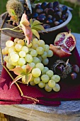 Grapes, sweet chestnuts, pomegranate and autumn leaves