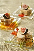 Goose liver canapés topped with fresh figs