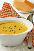 Pumpkin soup with snipped chives