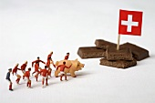 Pieces of chocolate, Swiss flag, toy footballers, pig