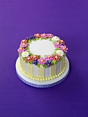 Summery cake with sugar flowers for special occasion