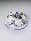 Cake with blue roses and bows for special occasion