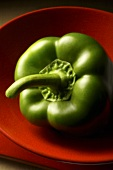 Green pepper in a red bowl