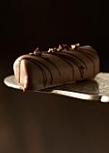 Coffee truffle on cake slice