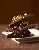 Triangular chocolates with caramel sprinkles