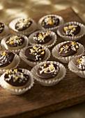 Filled orange chocolate truffles in paper cases
