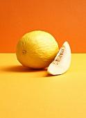 Honeydew melon on coloured background