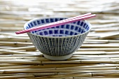 Empty Asian rice bowl with chopsticks