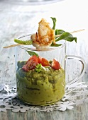 Guacamole in a glass, skewered prawn on top