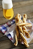 Puff pastry cheese straws and a glass of beer
