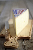 Piece of cheese on chopping board
