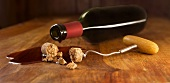 Red wine bottle, broken cork and corkscrew