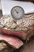 Sirloin steak with meat thermometer