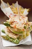 Grilled pita bread filled with asparagus and cheese, chips