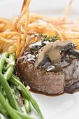 Beef fillet with mushrooms, gravy, green beans and chips