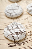 Decorating coconut macaroons with couverture chocolate
