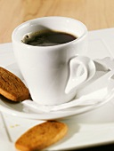 Espresso in white cup and saucer