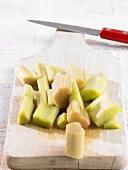 Pieces of rhubarb on chopping board