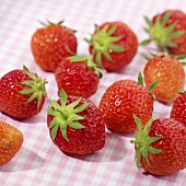 Strawberries on checked tablecloth