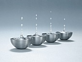 Drops of water over metal bowls