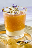 Persimmon puree with cream, pollen and violets