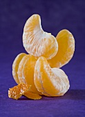 Mandarin orange segments and two small pieces of peel